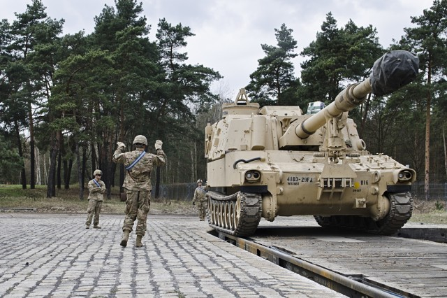 Soldiers with 3rd Battalion, 29th Field Artillery Regiment, 3rd Armored Brigade Combat Team, 4th Infantry Division, guide a Paladin Self-propelled Howitzer off of a railcar in Zagan, Poland March 29, 2017. The U.S. Field Artillery unit showcases its ability to deter aggression and assure NATO Allies by demonstrating the speed and efficiency at which it can rotate troops and equipment throughout the European theater. (U.S. Army photo by Sgt. Justin Geiger)