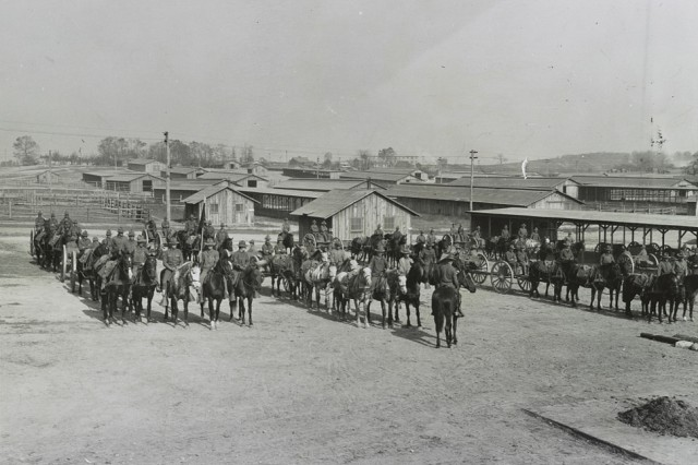 Army mounted cavalry and equipment form up at Camp Meade, Md., circa 1918.
