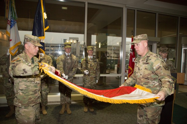 Lt. Gen. Paul M. Nakasone, commander of U.S. Army Cyber Command (left), and ARCYBER Command Sgt. Maj. William G. Bruns prepare to case the Second Army colors during a ceremony at Fort Belvoir, Va., March 31. Officially inactivated in January, Second Army has been associated with ARCYBER since the command's creation in 2010.