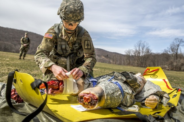 U.S. Army Spc. Courtney Natal provides aid to a simulated casualty during the New York Army National Guard Best Warrior Competition at Camp Smith Training Site March 30, 2017. The Best Warrior competitors represent each of New York's brigades after winning competitions at the company, battalion, and brigade levels. At the state level they are tested on their physical fitness, military knowledge, endurance, marksmanship, and land navigation skills. The two winners of the competition, one junior enlisted and one NCO, advance to compete at the regional level later this year.