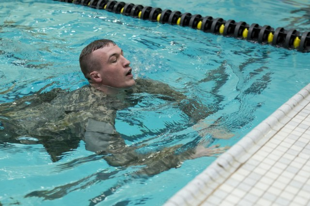 U.S. Army Sgt. Mitchell Cooper completes the 100m swim event during the New York Army National Guard Best Warrior Competition at the U.S. Military Academy, West Point, N.Y., March 31, 2017. The Best Warrior competitors represent each of New York's brigades after winning competitions at the company, battalion, and brigade levels. At the state level they are tested on their physical fitness, military knowledge, endurance, marksmanship, and land navigation skills. The two winners of the competition, one junior enlisted and one NCO, advance to compete at the regional level later this year.