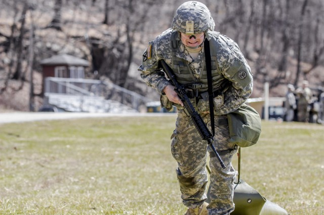A Soldier runs through the stress shoot lane combining physical tests and shooting events during the New York Army National Guard  Best Warrior Competition at Camp Smith Training Site March 30, 2017. The Best Warrior competitors represent each of New York's brigades after winning competitions at the company, battalion, and brigade levels. At the state level they are tested on their physical fitness, military knowledge, endurance, marksmanship, and land navigation skills. The two winners of the competition, one junior enlisted and one NCO, advance to compete at the regional level later this year.