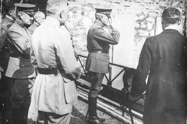 Upon his arrival in France in June 1917, Gen. John Pershing traveled to the tomb of  Marquis de Lafayette. Here, he is with French leaders saluting the U.S. Revolutionary War hero, who is also a hero of France, in an act of great diplomacy.