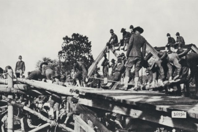 Soldiers at Camp Humphreys (now Fort Belvoir, Virginia), practice bridge building. The camp served as a World War I training camp.