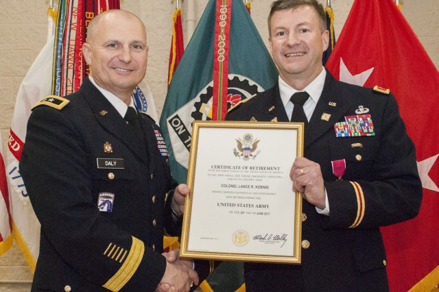 Maj. Gen. Edward Daly, senior commander at Rock Island Arsenal and commanding general, U.S. Army Sustainment Command, presents Col. Lance Koenig, chief of staff, ASC, a certificate of retirement during a ceremony for Col. Lance Koenig, chief of staff, ASC, in Heritage Hall, Rock Island Arsenal, Illinois, March 28.