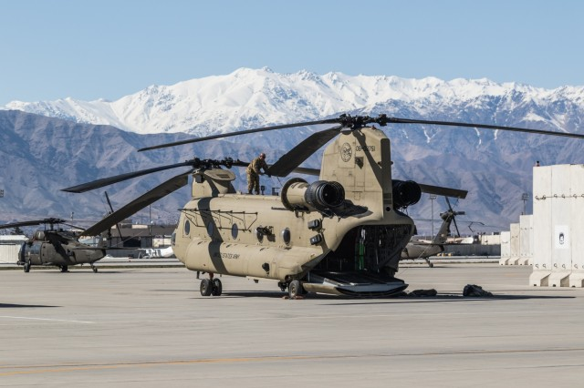 A U.S. Army CH-47 Chinook helicopter crew assigned to Task Force Flying Dragon, 16th Combat Aviation Brigade, 7th Infantry Division prepares for a flight at Bagram Airfield, Afghanistan, April 1, 2017. The Flying Dragons are preparing to assume their mission with U.S. Forces Afghanistan in support of Operation Freedom's Sentinel and Resolute Support Mission.