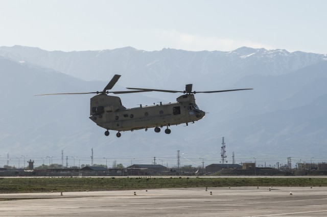 U.S. Army CH-47 Chinook helicopter pilots assigned to Task Force Flying Dragon, 16th Combat Aviation Brigade, 7th Infantry Division prepare to land at Bagram Airfield, Afghanistan, April 1, 2017. The Flying Dragons are preparing to assume their mission with U.S. Forces Afghanistan in support of Operation Freedom's Sentinel and Resolute Support Mission.