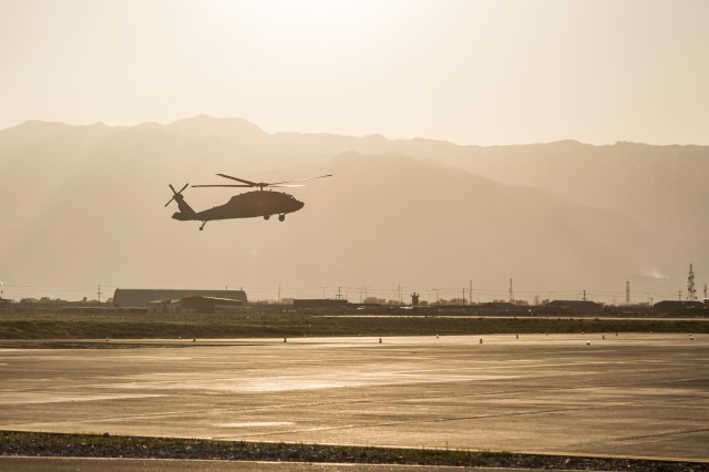 U.S. Army UH-60 Black Hawk helicopter pilots assigned to Task Force Flying Dragon, 16th Combat Aviation Brigade, 7th Infantry Division prepare for landing at Bagram Airfield, Afghanistan, April 1, 2017. The Flying Dragons are preparing to assume their mission with U.S. Forces Afghanistan in support of Operation Freedom's Sentinel and Resolute Support Mission.
