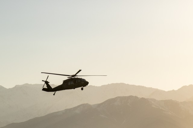 A U.S. Army UH-60 Black Hawk helicopter crew assigned to Task Force Flying Dragon, 16th Combat Aviation Brigade, 7th Infantry Division flies overhead at Bagram Airfield, Afghanistan, April 1, 2017. The Flying Dragons are preparing to assume their mission with U.S. Forces Afghanistan in support of Operation Freedom's Sentinel and Resolute Support Mission.