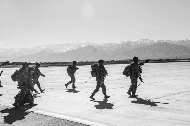 U.S. Army Soldiers assigned to 1st Squadron, 14th Cavalry Regiment, 1st Stryker Brigade Combat Team, 2nd Infantry Division move toward a CH-47 Chinook helicopter assigned to Task Force Flying Dragon, 16th Combat Aviation Brigade, 7th Infantry Division during training at Bagram Airfield, Afghanistan, April 1, 2017. The Cavalry troopers provide a ready response force for downed aircraft, and the training focused on preparing them to assume their mission in support of Operation Freedom's Sentinel and Resolute Support Mission.