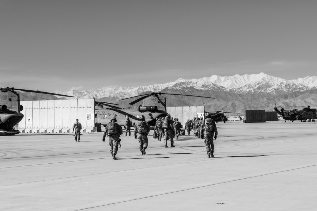 U.S. Army Soldiers assigned to 1st Squadron, 14th Cavalry Regiment, 1st Stryker Brigade Combat Team, 2nd Infantry Division exit a CH-47 Chinook helicopter assigned to Task Force Flying Dragon, 16th Combat Aviation Brigade, 7th Infantry Division during training at Bagram Airfield, Afghanistan, April 1, 2017. The Cavalry troopers provide a ready response force for downed aircraft, and the training focused on preparing them to assume their mission in support of Operation Freedom's Sentinel and Resolute Support Mission.