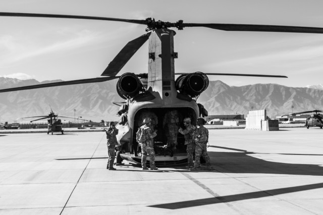 U.S. Army Soldiers assigned to 1st Squadron, 14th Cavalry Regiment, 1st Stryker Brigade Combat Team, 2nd Infantry Division load onto a CH-47 Chinook helicopter assigned to Task Force Flying Dragon, 16th Combat Aviation Brigade, 7th Infantry Division during training at Bagram Airfield, Afghanistan, April 1, 2017. The Cavalry troopers provide a ready response force for downed aircraft, and the training focused on preparing them to assume their mission in support of Operation Freedom's Sentinel and Resolute Support Mission.