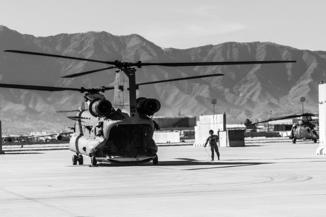 A U.S. Army CH-47 helicopter crew chief assigned to Task Force Flying Dragon, 16th Combat Aviation Brigade, 7th Infantry Division prepares for a flight carrying U.S. Army Soldiers assigned to 1st Squadron, 14th Cavalry Regiment, 1st Stryker Brigade Combat Team, 2nd Infantry Division during training at Bagram Airfield, Afghanistan, April 1, 2017. The Cavalry troopers provide a ready response force for downed aircraft, and the training focused on preparing them to assume their mission in support of Operation Freedom's Sentinel and Resolute Support Mission.