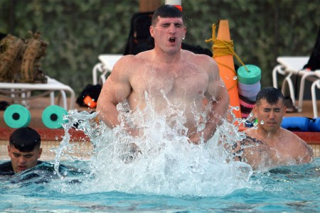 Spc. Kyler Hanstead, an infantryman, conducts aquatic training by performing squat jumps at Richardson Pool on Schofield Barracks, Hawaii, March 15, 2017. The physical training is one of several different times the 3rd Brigade Combat Team conducts as part of a week long Advanced Physical Training course.