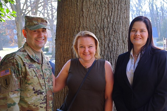 Maj. Aleyzer Mora, the assistant product manager for command centers at I3MP, handled the day-to-day activities of the tech refresh at Schofield Barracks, aided by Andi Fehl, center, the project team assist, and Sarah Mullins, the deputy assistant product manager for command centers. (U.S. Army photo by Scott Sundsvold)