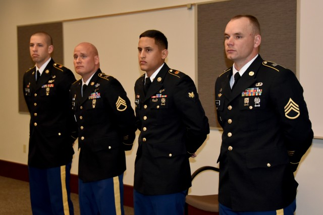 From left, Sgt. Justin Thompson, Staff Sgt. Theodore Wills, Spc. Manuel Martinez and Staff Sgt. Michael Holbein prepare to go before the board during the U.S. Army Space and Missile Defense Command/Army Forces Strategic Command's Pacific Region Best Warrior Competition March 26-29 in Wahiawa, Hawaii.