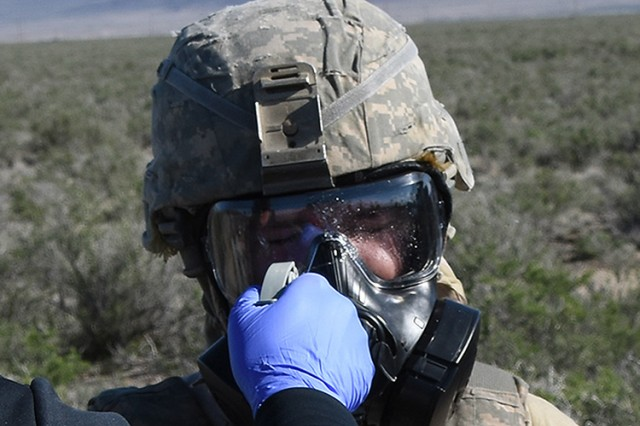 "A Soldier is ""contaminated"" with a simulated chemical agent during Mar. 28, 2017 testing of the Joint Services Equipment Wipe at Dugway Proving Ground, Utah. After sprayed by test personnel, the Soldier used the JSEW to remove the bulk of simulated agent from his M50 gas mask"