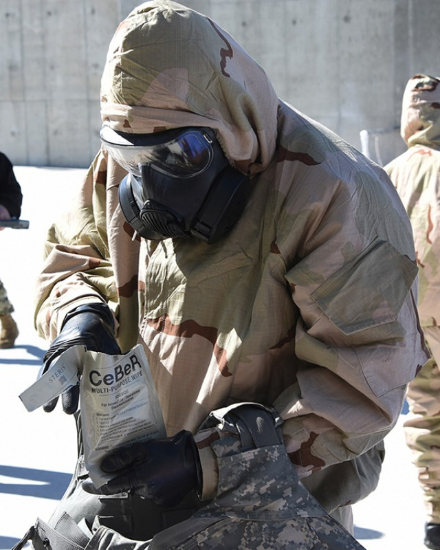Soldier removes JSEW towelette for decontamination