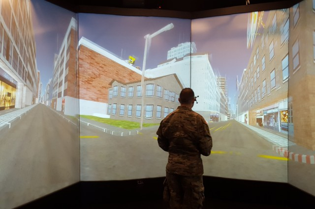 The Cognitive Science Team at the Natick Soldier Research, Development and Engineering Center is investigating how augmented reality, or AR, may help Soldiers improve their mission-planning skills. The Soldier pictured here uses virtual reality capabilities to perform a navigation exercise.