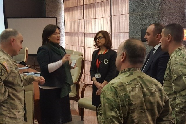 Col. David H. Carstens, the U.S. Army Europe inspector general, engages in a discussion on IG structures with the Georgian Ministry of Defense Inspector General Aleksandre Badzagua and Chief of Combat Readiness Monitoring Division Col. Merlani through an interpreter provided by the MoD) Feb. 14-16 in Tbilisi, Georgia.