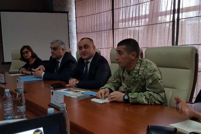 Col. Merlani , the Chief of Combat Readiness Monitoring Division,  Mr. Aleksandre Badzagua, Georgian Ministry of Defense Inspector General, Lt. Col. David Kariauli, the Head of Military Police, and Ms. Nino Karazanashvili, the Head of Internal Audit Services Department present their organizational structure briefs to members of the U.S. Army Europe OIG Feb. 14-16 in Tbilisi, Georgia.