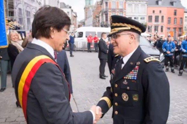"""Mayor of Mons Elio Di Rupo greets SACEUR Gen. Curtis Scaparrotti at the Hôtel de Ville for """"SHAPE Memories"""" unveiling April 1, 2017."""