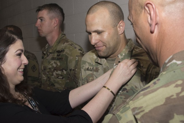 Staff Sgt. Daniel Barsi, with Headquarters and Headquarters Company, Army Training Center, has the Expert Infantryman Badge pinned on his chest March 31 in a ceremony at the Joe E. Mann Building on Fort Jackson.