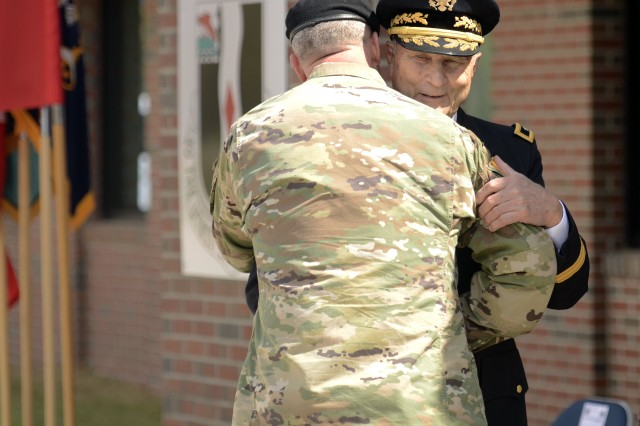 Fort Jackson's Commander Maj. Gen. Pete Johnson hugs retired Maj. Gen. Marvin Back who served as one of the chair members on the Matt Louis Urban board. The installation dedicated one of their buildings to World World II Medal of Honor Matt Urban during a ceremony March 31.