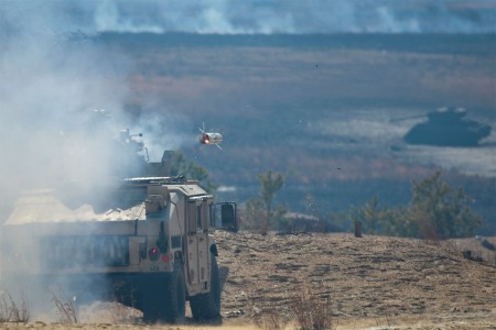 A U.S. Army National Guard Soldier from the 50th Infantry Brigade Combat Team fires a BGM-71 TOW missile at tank targets during training at Joint Base McGuire-Dix-Lakehurst, N.J., March 23, 2017. The tube-launched, optically tracked, wire-guided, is an American anti-tank missile.
