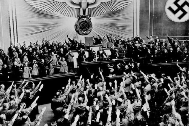 Adolf Hitler accepts the ovation of the Reichstag after announcing the peaceful acquisition of Austria. It set the stage to annex the Czechoslovakian Sudetenland, largely inhabited by a German- speaking population. Berlin, March 1938.