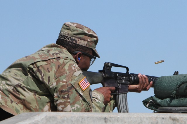 1st Sgt. Angelo Johnson, A Battery, 1st Battalion, 31st Field Artillery, fires an M-16 during the 40-round stress shoot.