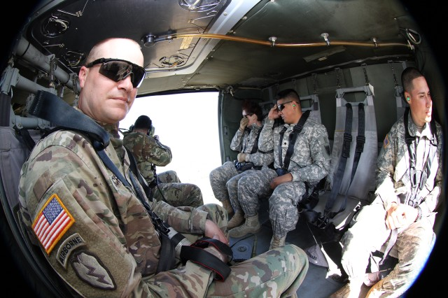 Soldiers relax in a UH-60 Black Hawk helicopter heading for the Humvee push challenge.