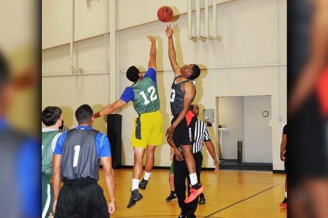 Players go for the toss up to start the first game of the 2017 Fort Rucker Intramural Basketball Post Championship Tournament at Fortenberry-Colton Physical Fitness Center April 4.