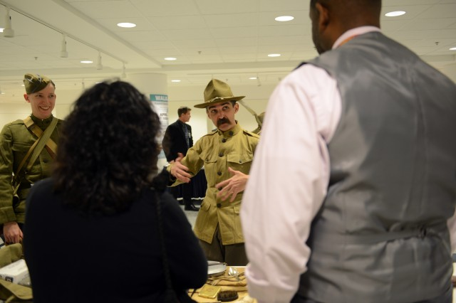 World War I re-enactors, or living historians, Todd Rambow, on the left, and Luke Clawson, center, talk with DOD civilians at an information booth set up, April 6, 2017, at the Pentagon. The booth was staffed by the Center for Military History on the 100th anniversary of the United States entering into World War I. It featured relics and weapons that will be displayed at the National Museum of the Army, which is now under construction.