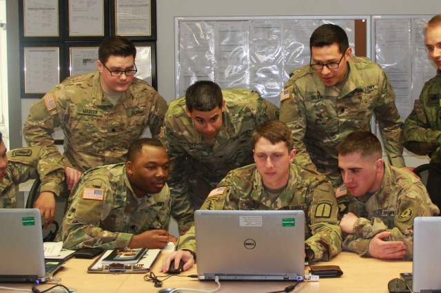 Soldiers going through the 7th Army Noncommissioned Officer Academy's Basic Leaders Course work together in squads to write an essay explaining how they will address Sexual Harassment / Assault Response & Prevention (SHARP) in their units.