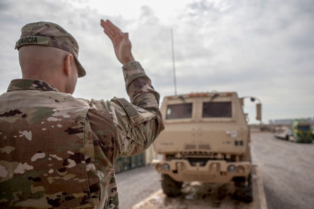 Army Sgt. 1st Class Henry Garcia, deployed in support of Combined Joint Task Force Operation Inherent Resolve and assigned to 583rd Forward Support Company, loads a vehicle for transportation near Irbil, Iraq, March 21, 2017.