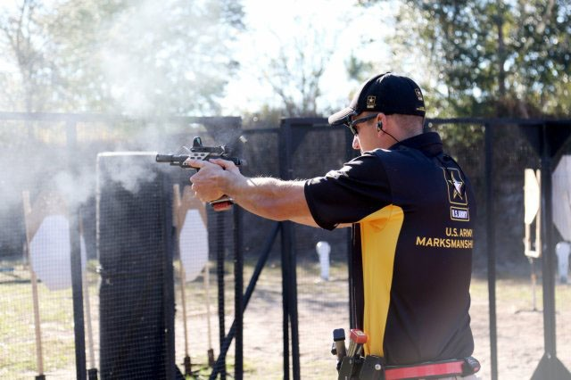 STAFF SGT. BRAD BALSLEY, AN ACTION SHOOTING TEAM SOLDIER WITH THE ARMY MARKSMANSHIP UNIT, FIRES ON A TARGET at the Florida Open February 17. The Florida Open, which was in Frostproof, Florida, was the first match of the competition season for the AMU's Action Shooting Team. Balsley placed second place in the Open Division.