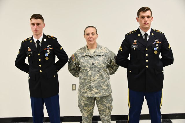 53rd Signal Battalion Command Sgt. Maj. Mary A. Carr, stands with Spc. Samuel Leznik, left, and Cpl. Evan Howell, both with B Company, 53rd Signal Batt., after they were named the U.S. Army Space and Missile Defense Command/Army Forces Strategic Command's Eastern Region Best Warrior Competition winners. The command's eastern region competition was hosted April 4-6 at Fort Meade and Camp Fretterd, Maryland.
