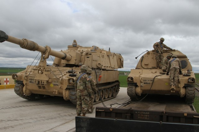 Soldiers from Alpha Battery, 3rd Battalion, 29th Field Artillery Regiment connect jumper cables from an M109A6 Paladin Self Propelled Howitzer to a M99A2 Field Artillery Ammunition Support Vehicle. These vehicles will be used by U.S. and Romanian forces to become a cohesive fighting force in support of Operation Atlantic Resolve, a NATO mission involving the U.S. and European Allies and partners that enhances bonds of friendship and strengthens regional stability. (U.S. Army photo by Pvt. Nicholas Vidro, 7th Mobile Public Affairs Detachment)