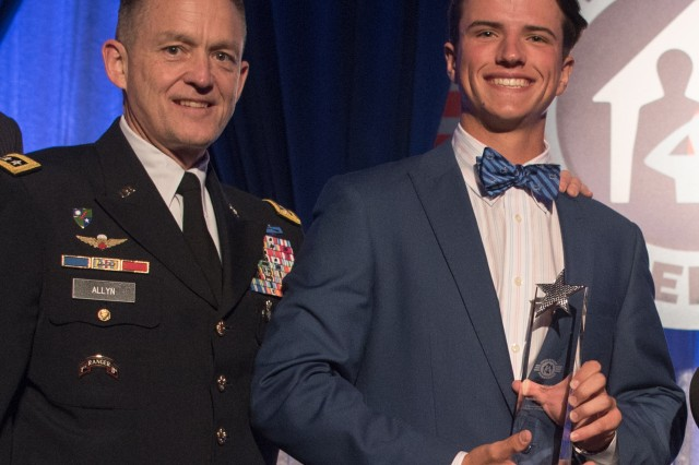 Henderson Heussner receives the Operation Homefront 2017 Army Military Child of the Year Award from Gen. Daniel B. Allyn, vice chief of staff of the Army, April 6, 2017. Henderson is the son of Col. Todd Heussner of the Army Materiel Command at Redstone Arsenal, Ala.