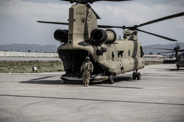 A U.S. Army CH-47 helicopter crew chief assigned to Task Force Flying Dragons, 16th Combat Aviation Brigade, 7th Infantry Division prepares for a flight at Operating Base Fenty, Afghanistan, April 5, 2017. The Flying Dragons are preparing to assume their mission in support of Operation Freedom's Sentinel and Resolute Support Mission.
