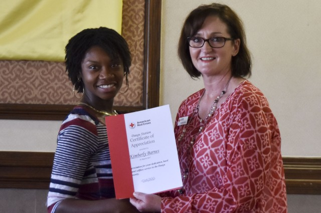 Red Cross volunteer Kimberly Barnes receives certificate in appreciation for her dedication to Area IV community.
