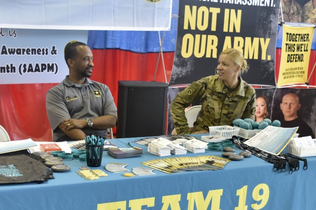 Eric Alleyne and Maj, Joanna Robisch have a conversation during the SHARP First Responder Fair on Apr. 4.