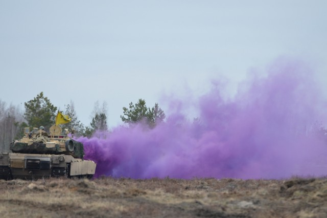 Company A, 1st Battalion, 68th Armor Regiment, 3rd Armored Brigade Combat Team, 4th Infantry Division, Fort Carson, Colo., pops a canister of purple smoke on a range in Adazi Military Base, Latvia, April 9.  The smoke color signifies loss of global positioning systems and loss of radio communication to the other vehicles on the range, thereby changing the method of communication to flag signals in the scenario.  The 3rd ABCT is a multifunctional armored brigade combat team trained to operate, respond quickly and retain the ability to communicate in any environment.  The brigade is deployed to Eastern Europe under Operation Atlantic Resolve, a U.S. led NATO endeavor to promote peace in the region by deterring aggressive actions.  (U.S. Army photo by Sgt. Shiloh Capers)