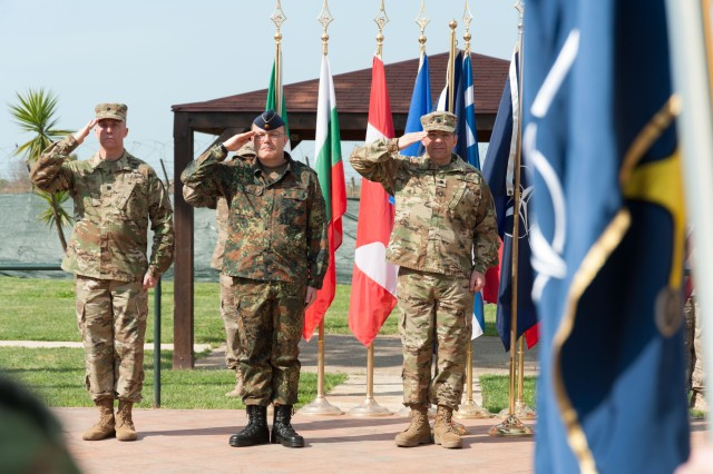 From left to right, incoming commander, Lt. Col James Dooley, German Maj. Gen. Walter Huhn, the NATO CIS Group commander, and outgoing commander, Lt. Col. John Hinkel, salute the colors  during a change of command ceremony for 2nd NATO Signal Battalion at Grazzanise, Italy Apr. 4. With approximately 140 U.S. Soldiers assigned to its ranks, the 2NSB is the largest single concentration of U.S. Army Personnel in a NATO organization. U.S. Army personnel fill roles within the battalion ranging from mechanics and technicians, all the way up to the commander and senior enlisted leader.