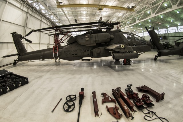 South Carolina Army National Guard Soldiers with 1-151st Attack Reconnaissance Battalion, 59th Aviation Troop Command, participate in an operational testing-exercise for a new AH-64 blade-folding kit at McEntire Joint National Guard Base in Eastover, South Carolina, Apr. 5, 2017. The test included the loading of an AH-64 Apache helicopter on a C-17 Globemaster III cargo aircraft, multiple combat take-offs and landings, and the final unloading of the AH-64.
