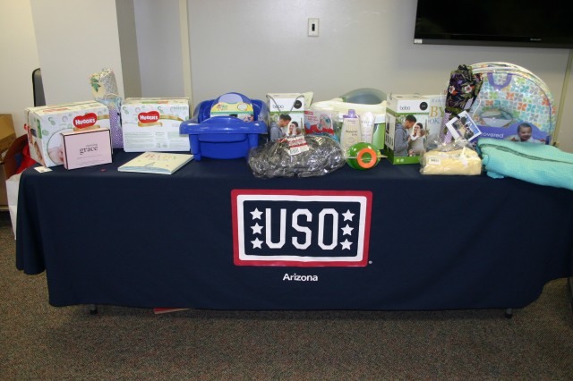 Expectant mothers competed for prizes and chose from the table of gifts donated by the USO during the baby shower event held April 7 at Raymond W. Bliss Army Health Center.