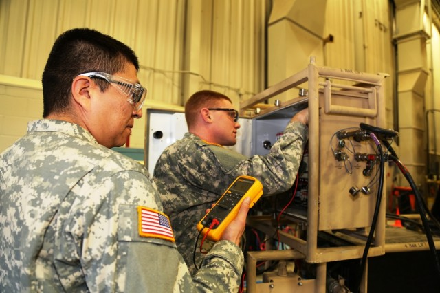 Spc. Nathaniel Begay with the 877th Quartermaster Company at Kirtland Air Force Base, N.M., and Spc. Hunter Blehm with the 792nd Chemical Company at Grand View, Wash., both students in the Chemical and Quartermaster Equipment Repair Course at Regional Training Site-Maintenance, work on a class project Feb. 10, 2017, at Fort McCoy, Wis. The class teaches Soldiers classifying into the Army's 91J military occupational specialty. (U.S. Army Photo by Scott T. Sturkol, Public Affairs Office, Fort McCoy, Wis.)