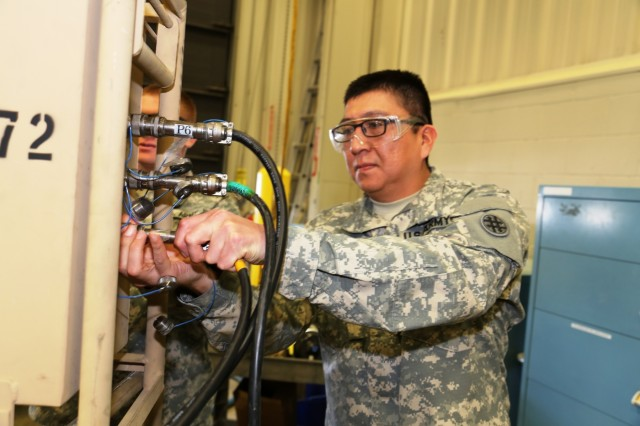 Spc. Nathaniel Begay with the 877th Quartermaster Company at Kirtland Air Force Base, N.M., a student in the Chemical and Quartermaster Equipment Repair Course at Regional Training Site-Maintenance, works on a class project Feb. 10, 2017, at Fort McCoy, Wios. The class teaches Soldiers classifying into the Army's 91J military occupational specialty. (U.S. Army Photo by Scott T. Sturkol, Public Affairs Office, Fort McCoy, Wis.)