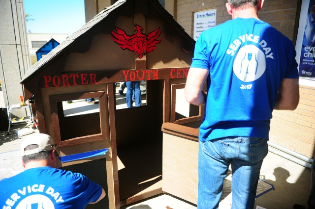 PRESIDIO OF MONTEREY, California -- A children's playhouse destined for Presidio's Porter Youth Center receives its final touches from Brown-Forman Service Day participants outside the Habitat for Humanity Monterey Bay ReStore in Seaside, CA.